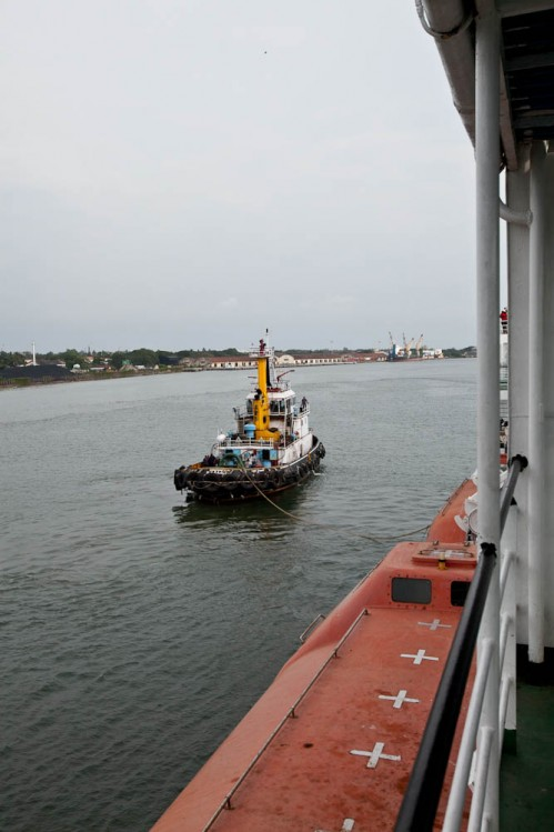 Tug pulling ship from the parking bay