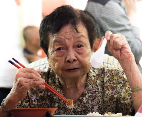 Lady at Hawker Centre Food Court
