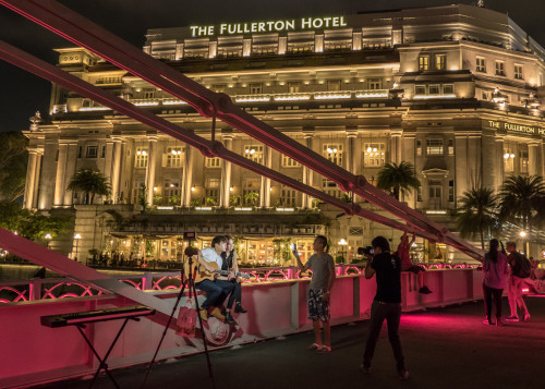 Fullerton Hotel with some photoshoot going on Cavengh Bridge